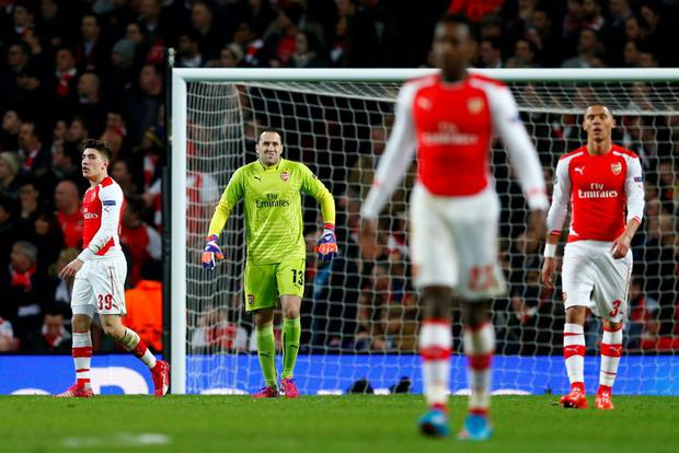 Football - Arsenal v AS Monaco - UEFA Champions League Second Round First Leg - Emirates Stadium, London, England - 25/2/15 Arsenal's David Ospina, Kieran Gibbs and Hector Bellerin look dejected with team mates Reuters / Eddie Keogh Livepic EDITORIAL USE ONLY.