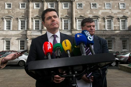 (L to R) Paschal Donohoe TD, Minister for Transport, Tourism and Sport & Chair of the Oireachtas Joint Committee on Transport John O'Mahony TD speaking to media on the Government's position on IAG's proposal to make an offer for Aer Lingus at the Plinth of Leinster House, Dublin. Photo: Gareth Chaney Collins