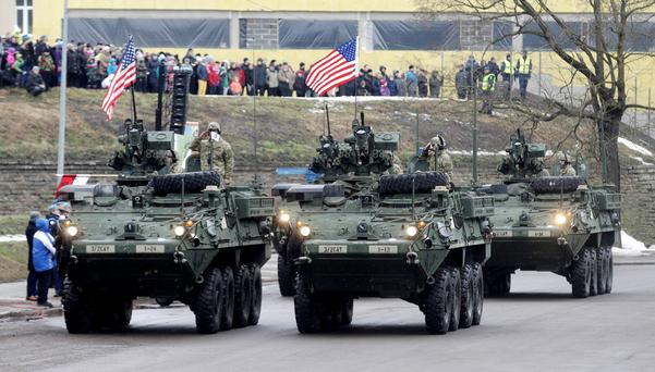 American troops parade less than 300 metres from Estonia's border with Russia yesterday, in a display of unity against the encroaching threat from Moscow