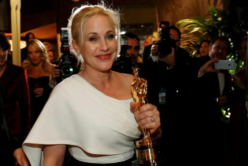 Patricia Arquette holds her Oscar for best supporting actress for her role in 'Boyhood' at the Governors Ball, following the 87th Academy Awards
