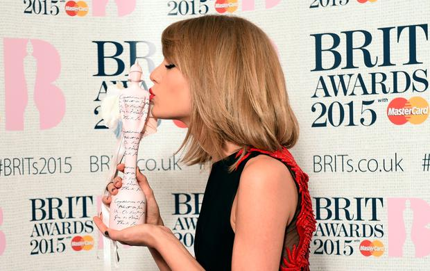 US singer Taylor Swift poses with her International Female Solo Artist award at the BRIT Awards