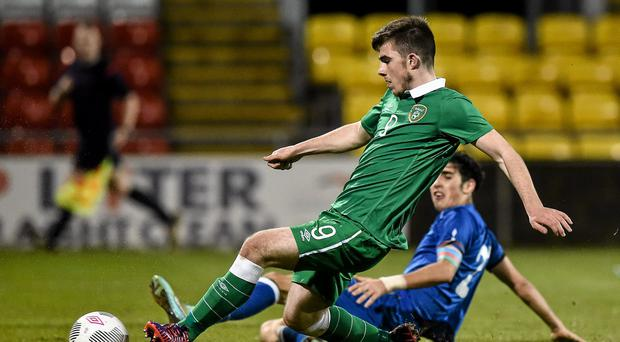 Ryan Manning, Republic of Ireland, shoots to score his side's fifth goal.