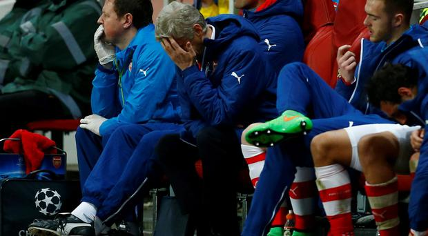 Arsene Wenger looks dejected during Arsenal's 3-1 home defeat to Monaco in the Champions League
