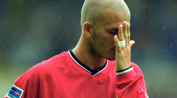 David Beckham pictured with his freshly shaven head during the 2000 Charity Shield