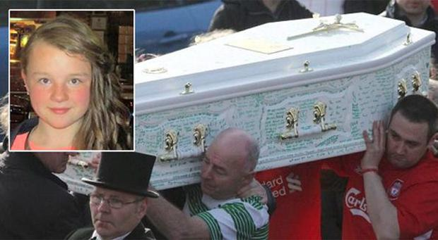 The remains of 13 yr old Georgia Doherty are carried into St Columba's Church by her heart broken father George and other family members.