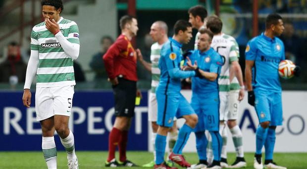 Celtic's Virgil van Dijk looks dejected after being sent off against Inter Milan.