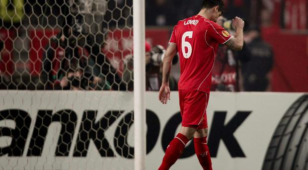Dejan Lovren of Liverpool reacts after failing to score a penalty in their Europa League round of 32 second leg soccer match against Besiktas.