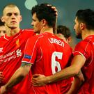 Dejan Lovren of Liverpool is consoled by Martin Skrtel (L) and Emre Can (R) after missing the decisive kick in the penalty shoot out against Besiktas JK