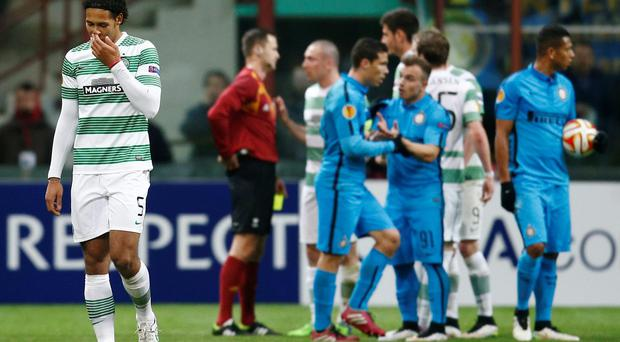 Celtic's Virgil van Dijk leaves the pitch after being sent off in the San Siro