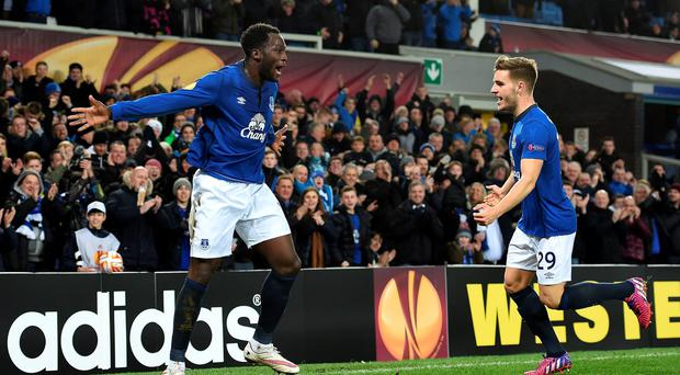 Everton's Romelu Lukaku celebrates scoring his side's second goal of the game with teammate Luke Garbutt (right)