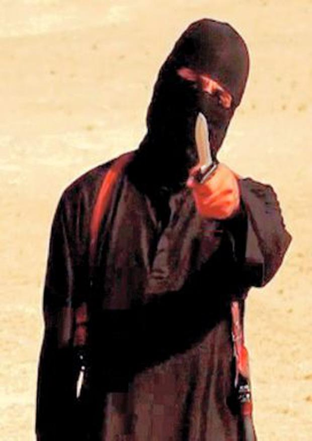 Mohammed Emwazi, who has been identified in reports as Jihadi John, in his executioner's stance