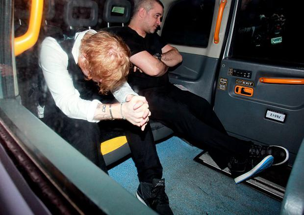Ed Sheeran is pictured leaving The Warner music after party a little worse for wear