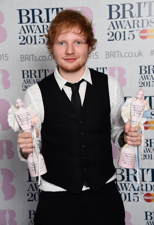 Ed Sheeran, winner of the Best British Male Solo Artist and Album Of The Year, poses in the winners room during the BRIT Awards 2015 at The O2 Arena