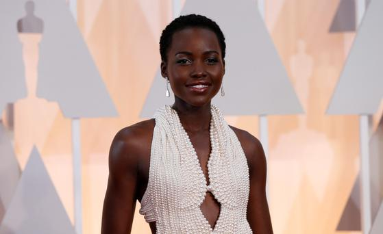 Actress Lupita Nyong'o paired her Calvin Klein gown with Chopard diamonds. Reuters/Mario Anzuoni/Files