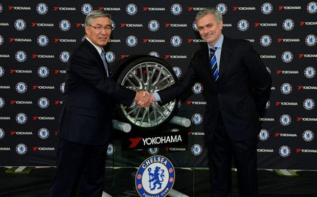 Handout photo provided by Chelsea FC of Yokohama Rubber Chairman Mr Nagumo with Chelsea manager Jose Mourinho during the announcement of Chelsea's New Shirt Sponsor Yokohama at Stamford Bridge, London