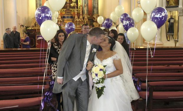 Christine Gibbons & Vincent Callaghan during their wedding at St Francis Xavier Street Gardener Street Church, Dublin