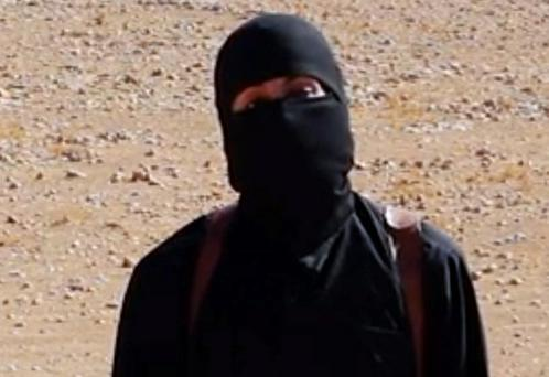A frame from a video released Friday, Oct. 3, 2014, by Islamic State militants that purports to show the militant who beheaded of taxi driver Alan Henning