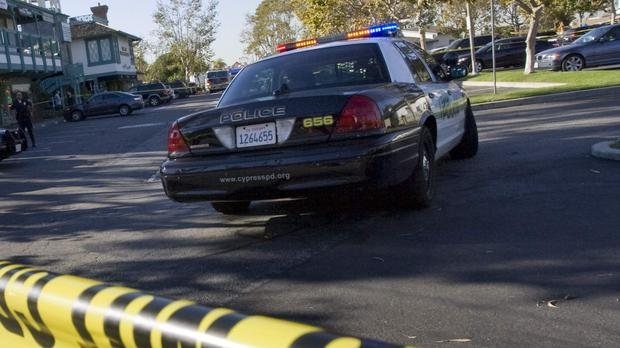 Crime scene tape at a mini mall where a deadly shooting occurred at Salon Meritage in Seal Beach, leaving eight people dead, one critically wounded and the alleged gunman in custody in Seal Beach, California, October 12, 2011