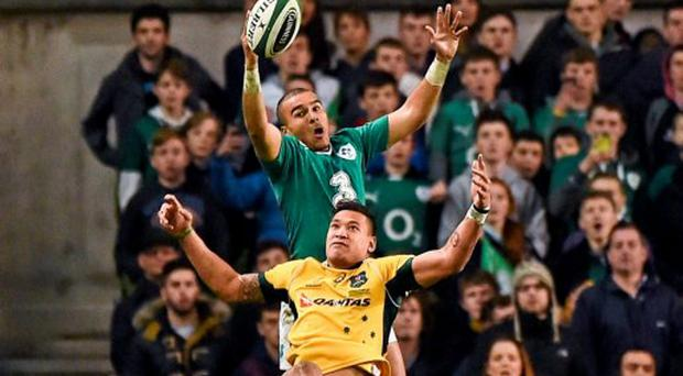 Simon Zebo, Ireland, contests a high ball with Israel Folau, Australia