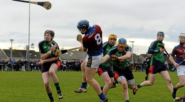 Jason Forde, UL, is blocked down by David Dempsey, LIT