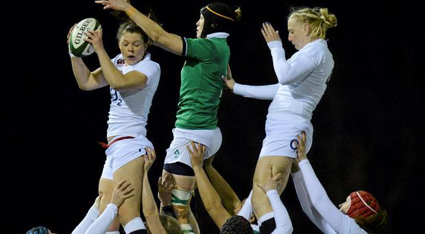 27 February 2015; Abbie Scott, England, wins possession in the lineout, supported by team-mate Abbie Scott, ahead of Marie Louise Reilly, Ireland. Women's Six Nations Rugby Championship, Ireland v England. Ashbourne RFC, Ashbourne, Co. Meath. Picture credit: Piaras ? M?dheach / SPORTSFILE