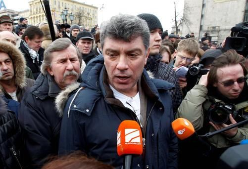 Opposition leader Boris Nemtsov speaks to the media during a gathering of opposition supporters in central Moscow. Reuters