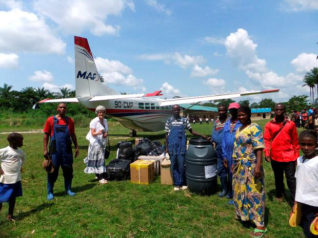 Maud Kells (third left) arriving back in Mulita, Democractic Republic of Congo in October 2014 with her baggage and supplies after a long journey from Cookstown via Belfast-London-Uganda. Maud Kells/PA Wire