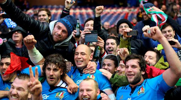 Italy's captain, Sergio Parisse (centre) celebrates with their fans after the RBS Six Nations match at Murrayfield Stadium, Edinburgh. PRESS ASSOCIATION Photo. Picture date: Saturday February 28, 2015. See PA story RUGBYU Scotland. Photo credit should read: Lynne Cameron/PA Wire