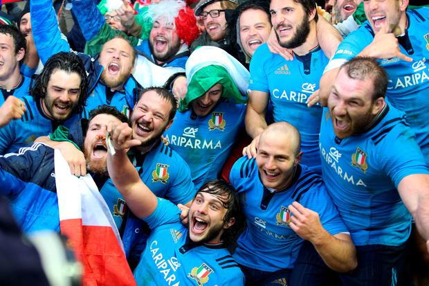 Italy's Enrico Bacchin (front centre) celebrates with their fans after the RBS Six Nations match at Murrayfield Stadium, Edinburgh. PRESS ASSOCIATION Photo. Picture date: Saturday February 28, 2015. See PA story RUGBYU Scotland. Photo credit should read: Lynne Cameron/PA Wire