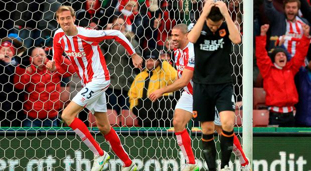 Stoke City's Peter Crouch celebrates scoring the first goal during the Barclays Premier League match at the Britannia Stadium