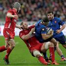 Wales' Alun Wyn Jones (2nd L) tackles France's Guilhem Guirado (2nd R) during their Six Nations rugby union match at the Stade de France stadium in Saint-Denis, near Paris, February 28, 2015. REUTERS/Philippe Wojazer
