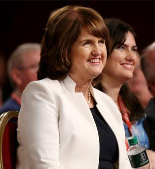 Tanaiste and Leader of the Labour Party, Joan Burton sits with the delegates during the Social and Econimic Recovery discussion at the Labour Party national Conference in the Gleneagle Hotel in Killarney. 28/2/15 Pic Frank Mc Grath
