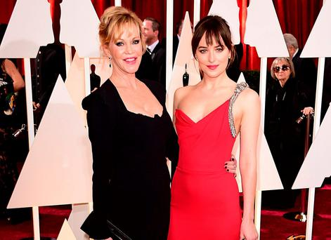 Melanie Griffith and with daughter Dakota Johnson at the Oscars