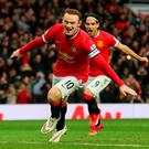 Wayne Rooney celebrates after giving Manchester United the lead from the penalty spot in their Premier League clash with Sunderland at Old Trafford. Photo: Alex Livesey/Getty Images