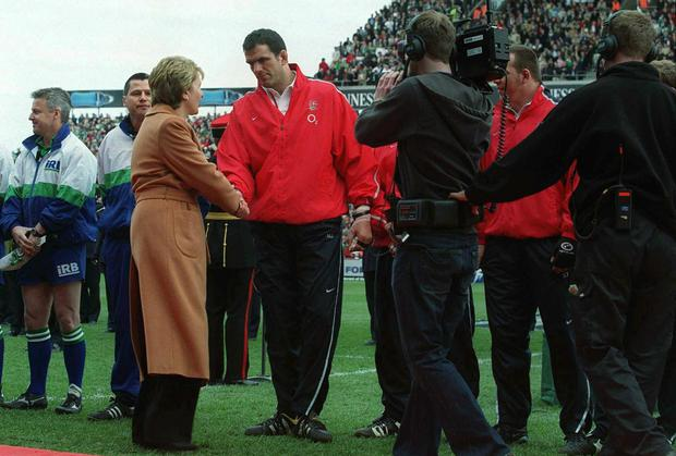 Flashback to 2003... President Mary McAleese greets Martin Johnson who had earlier breached protocols about where to stand. Photo: Brendan Moran / SPORTSFILE
