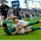 1 March 2015; Robbie Henshaw, Ireland, scores his side's first try despite the tackle of Alex Goode, England. RBS Six Nations Rugby Championship, Ireland v England. Aviva Stadium, Lansdowne Road, Dublin. Picture credit: Matt Browne / SPORTSFILE