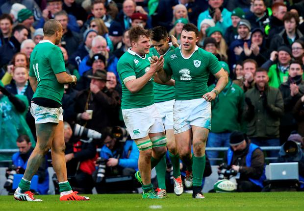 DUBLIN, IRELAND - MARCH 01: Robbie Henshaw (R) of Ireland is congratulated by teammates after scoring the opening try during the RBS Six Nations match between Ireland and England at the Aviva Stadium on March 1, 2015 in Dublin, Ireland. (Photo by Alex Livesey/Getty Images)