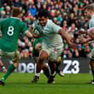 England's number 8 Billy Vunipola (C) makes a break during the Six Nations international rugby union match between Ireland and England at Aviva Stadium in Dublin, Ireland on March 1, 2015. Ireland won the game 19 - 9. AFP PHOTO / PAUL ELLISPAUL ELLIS/AFP/Getty Images