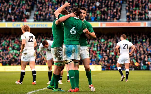 Ireland players celebrate at the final whistle in the Six Nations international rugby union match between Ireland and England at Aviva Stadium in Dublin, Ireland on March 1, 2015. Ireland won the game 19 - 9. AFP PHOTO / PAUL ELLISPAUL ELLIS/AFP/Getty Images