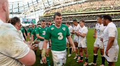 Peter O'Mahony, Ireland, leads his team-mates from the field after the game