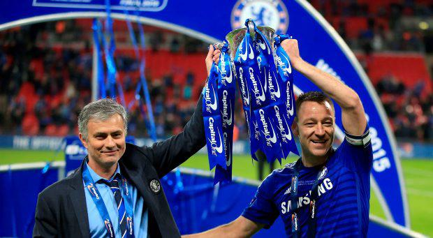 Chelsea manager Jose Mourinho (left) and John Terry (right) celebrate winning the Capital One Cup final with the trophy at Wembley, London