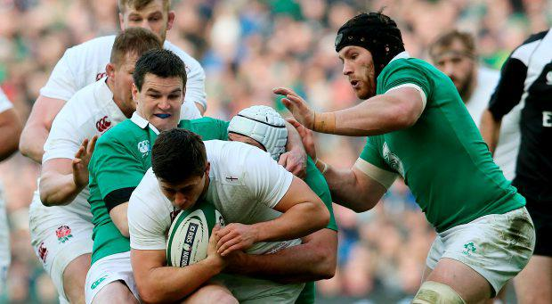 England's Ben Youngs is tackled by Ireland's Johnny Sexton (left) and Sean O'Brien during the RBS Six Nations match at the Aviva Stadium, Dublin