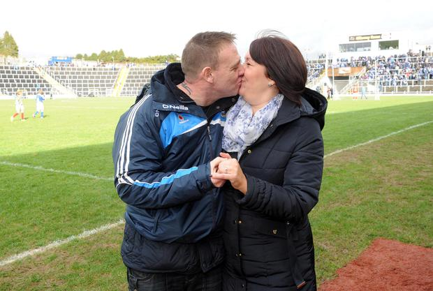 Andy Smith and Colette Smith, Donaghmede, Dublin, celebrate their engagement during the half time break at the Kerry versus Dublin national football league clash at Fitzgerald Stadium, Killarney on Sunday