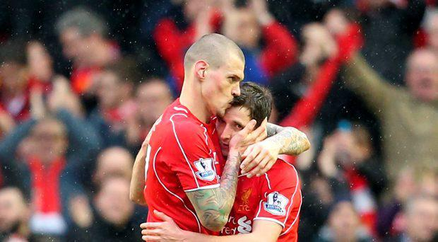 Liverpool's Martin Skrtel (left) celebrates victory with Joe Allen after the Barclays Premier League match at Anfield, Liverpool