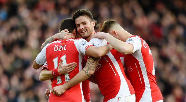 Arsenal's Tomas Rosicky celebrates scoring their second goal with Olivier Giroud and Mesut Ozil