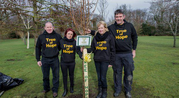 The Tree of Hope Team planting a tree. L to R: Chris Collins, Ashling Stanley, Noeleen and Niall Fulham