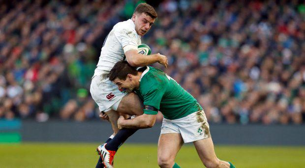 Ireland's Jonathan Sexton tackles England's George Ford