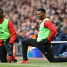 Liverpool's Mario Balotelli and Daniel Sturridge warm up on the side lines during the match