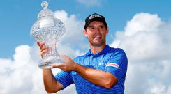 Padraig Harrington of Ireland poses with the trophy after winning The Honda Classic