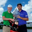 Padraig Harrington (R) of Ireland and his caddie Ronan Flood (L) pose with the trophy after winning The Honda Classic at PGA National Resort & Spa - Champion Course on March 2, 2015 in Palm Beach Gardens, Florida. (Photo by David Cannon/Getty Images)